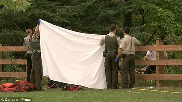 Crime scene: Police, pictured, discovered the woman's body around 6pm on Friday