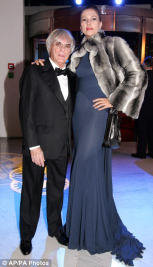 Aiming high: Ecclestone, left, and his former wife Slavica pose prior to the 2005 FIA Awards gala