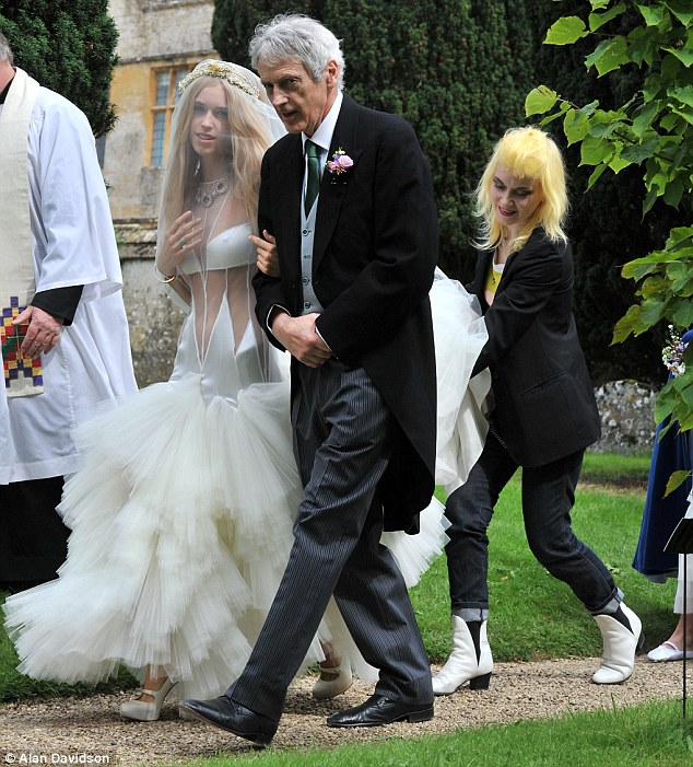 Making a fuss: Pam Hogg, who can count Lady Gaga as a big fan of hers, was seen holding Lady Mary's dress for her