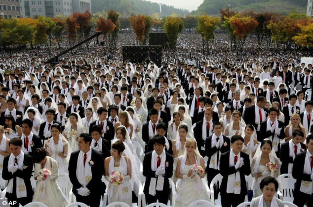Mass nuptials: Couples from around the world participate in a mass wedding ceremony arranged by the Rev. Sun Myung Moon's Unification Church at Sun Moon University in Asan