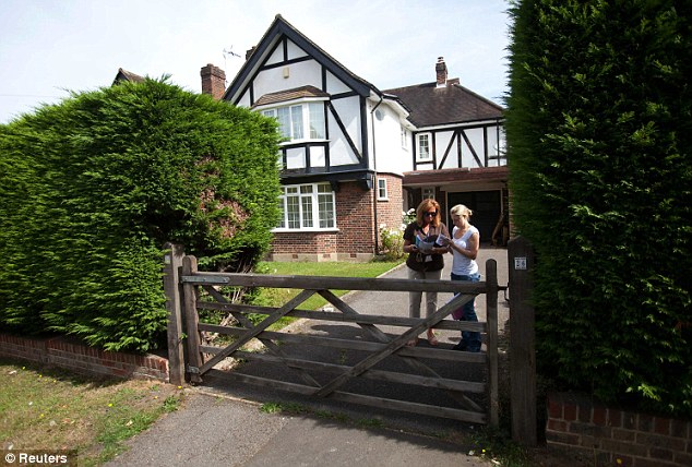 London link: Plain-clothes police officers stand outside of the home of Saad Al-Hilli in Claygate, Surrey