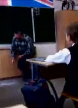 Oof: The bullying teacher crumples up in pain