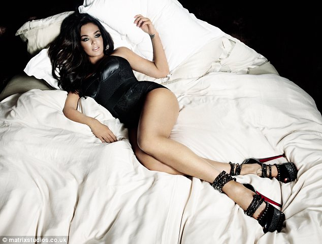 In bed with the heiress: In another shot Tamara is seen dressed in only a basque and sky-high Louboutin heels as she reclines on a bed