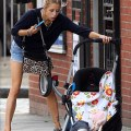 Peaches geldof spills the baby but not her phone as she scoops him up