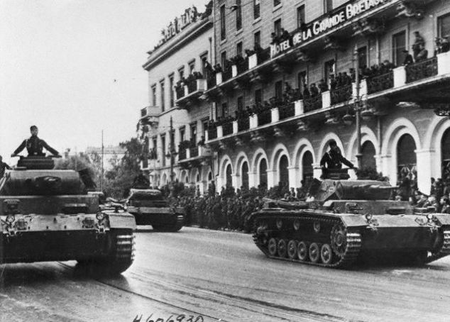 German tanks rumbling through the historic streets of Greek capital Athens as the conquering soldiers stage a victory parade in 1941