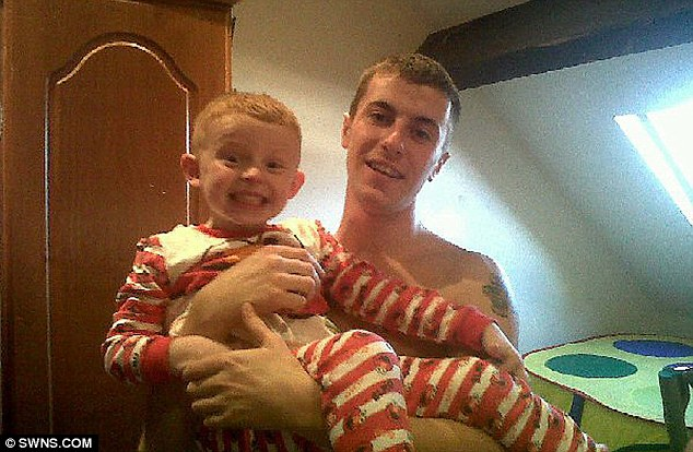 Risk to the public: Gavin Cawser pictured holding his girlfriend's son Dylan Crean, who he battered to death. An official report today criticises social workers and probation officers for not doing more to prevent the murder