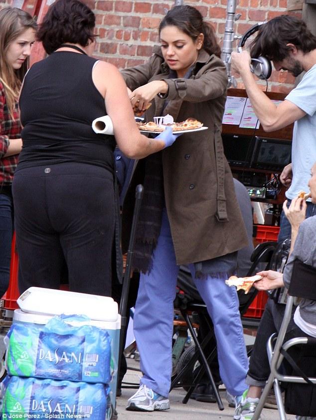 Mila Kunis Tucks Into Pizza On Break From New Film The