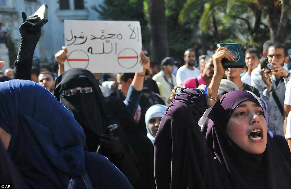 Shouting: Conservative Muslim women protest with copies of the Koran in Casablanca, Morocco