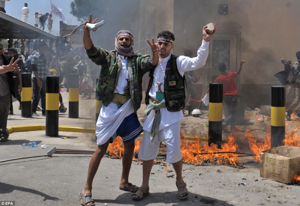 Attack: Yemeni protesters storm the US embassy during a protest. Yemen's embassy in Washington said no casualties were reported