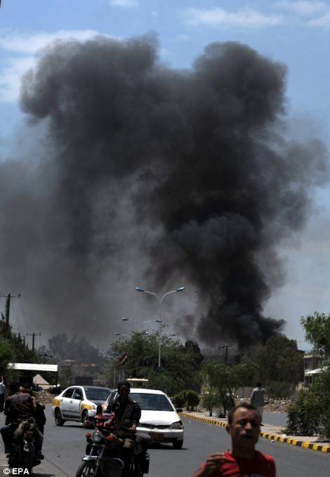 Heavy smokes rises from the US embassy in Sana'a