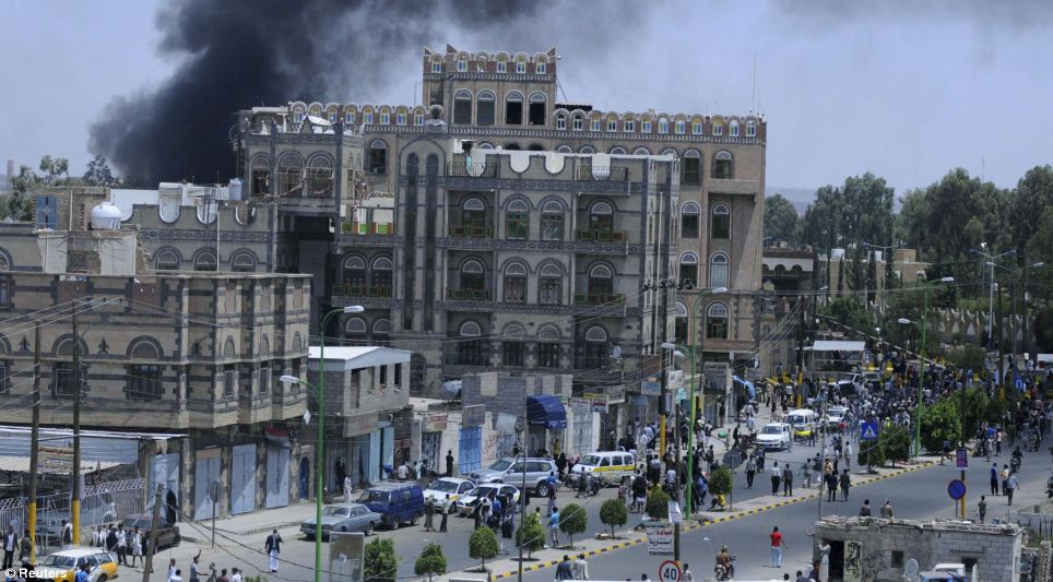 Fury: Smoke rises above the U.S. Embassy building in Yemen amid angry protests in the capital today
