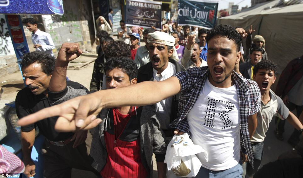 Growing momentum: Protests have already begun to spread to other countries following the scenes outside the U.S. Embassy in Yemen (above)