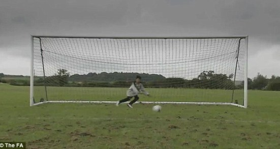 No chance: A young goalkeeper playing in a full-size goal in the FA campaign video