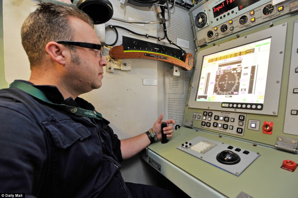 Technology: Leading engineering technician Andrew Gee tests out the sub's steering system in the control room