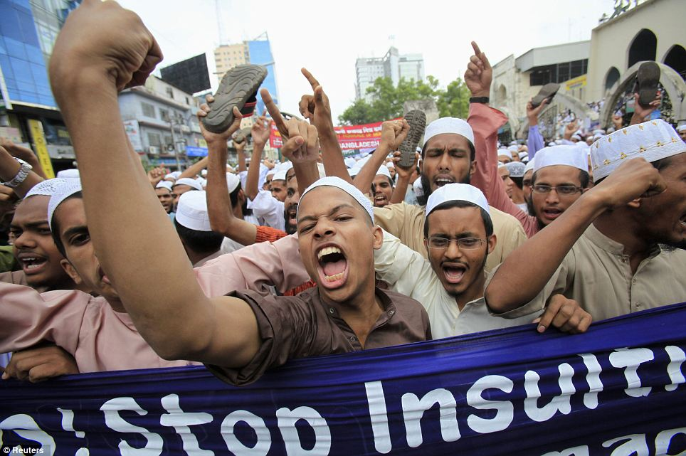 Anger: Bangladeshi Muslims shout slogans during a protest in front of the National Mosque in Dhaka