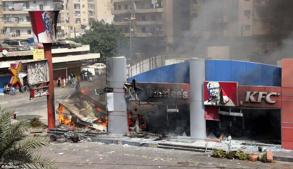 Flaming chicken: A Hardee's and a Kentucky Fried Chicken (KFC) fast food outlet burns after protesters set the building on fire in Tripoli, northern Lebanon