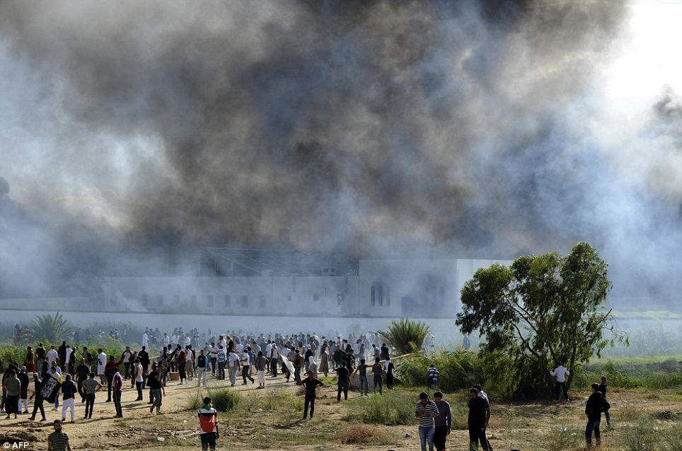 Smoke rises from the US embassy building in Tunis