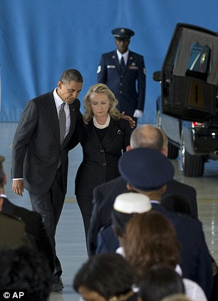 US President Barack Obama and State Secretary Hillary Clinton return to their seats after speaking