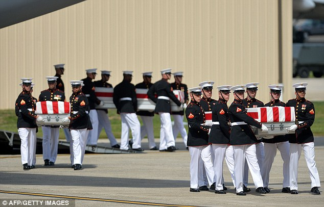 US Marines carry the caskets during the transfer of remains ceremony marking the return to the US of the remains of the four Americans killed in an attack this week in Benghazi, Libya