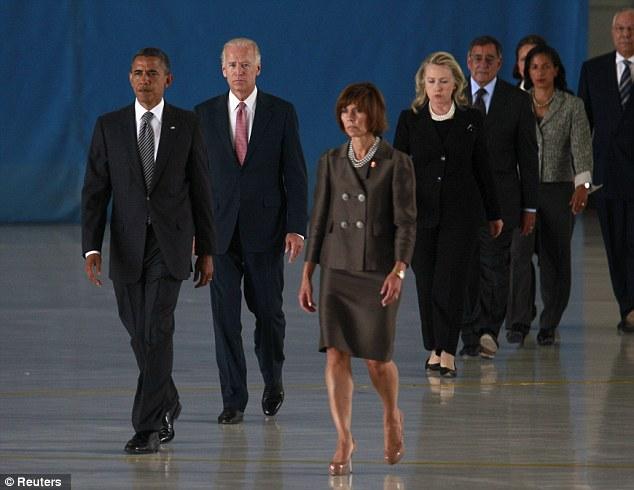 U.S. President Barack Obama, Vice President Joe Biden, Secretary of State Hillary Clinton and Defense Secretary Leon Panetta arrive at a transfer of remains ceremony