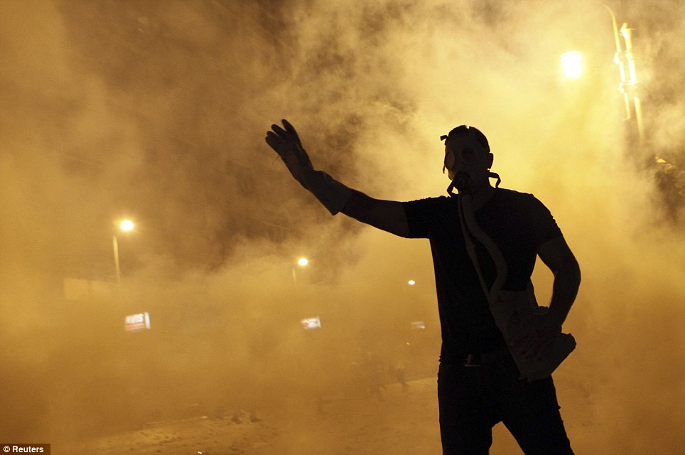The west created this monster by helping overthow the previous egyptian regime Dangerous: A protester throws a tear gas canister, which was earlier thrown by riot police, during clashes along a road at Kornish El Nile which leads to the U.S. embassy, near Tahrir Square in Cairo today