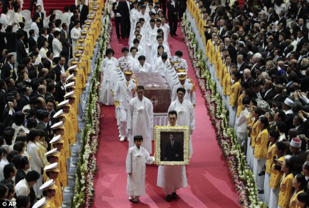 Procession: Moon is survived by his wife and 10 of their 13 children. But his eldest son Hyun Jin, the chairman of UCI, which owns the UPI news agency, did not attend the funeral. Church officials did not give details about why he was not there