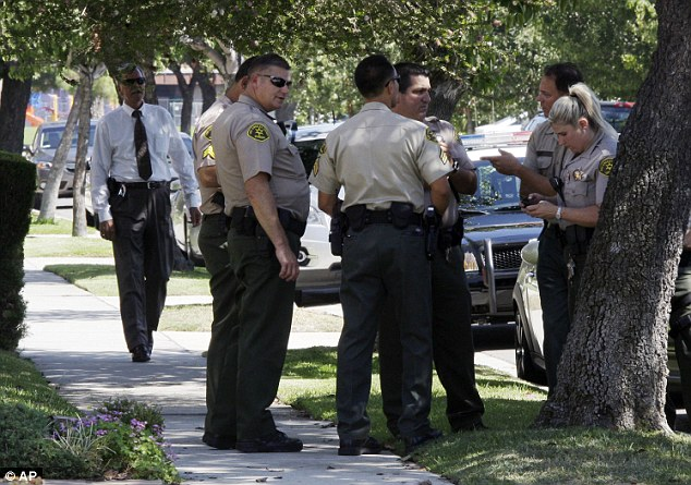 Los Angeles County sheriff's deputies stand down the street from the suburban Los Angeles home of filmmaker Nakoula Basseley Nakoula
