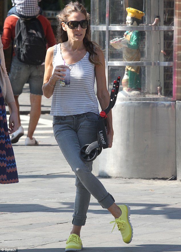 Sarah Jessica Parker finally dons trainers after stilettos