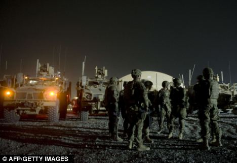 Night patrol: Infantry men from the 1st platoon, Delta company attend a briefing prior to embarking on night patrol in Kandahar province