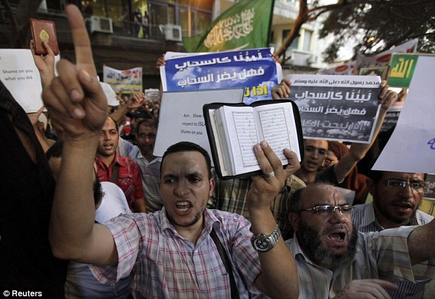 Seething masses: People shout and hold slogans in front of the U.S. embassy during a protest in Cairo September 11, 2012