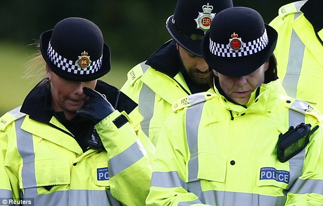 Tears: Poilce officers gather at the scene where the two policewomen were killed in Hattersley