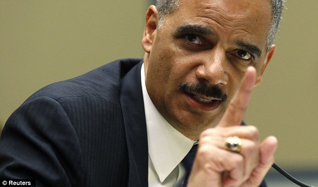 Escape: Attorney General Eric Holder was cleared of any wrongdoing in the Fast and Furious probe, but the report found that he should have been briefed on the investigation