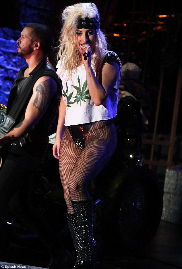 Eighties style: Gaga appeared to be channelling Blondie singer Debbie Harry with her blonde hair and headband