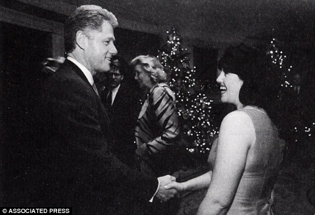 Admiration: A December 1996 White House photo shows Clinton and Lewinsky at a Christmas party