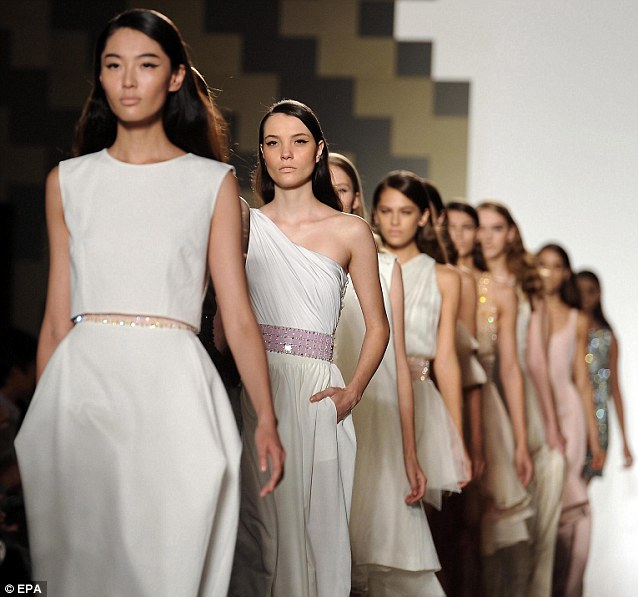 Models present creations by Mila Schoen during Milan Fashion Week