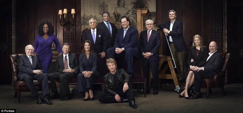 Spreading the wealth: Billionaires (l-r) Warren Buffet, Oprah Winfrey, Bill and Melinda Gates, Pete Peterson, Leon Black, Jon Bon Jovi, Marc Benioff, David Rubenstein, Steve Case, Laura Arrillaga-Andreessen and Marc Andreessen