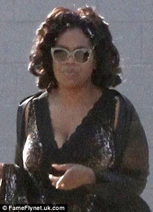 Oprah Winfrey shows off her curves as she steps out in