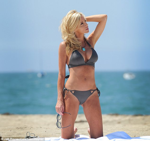 You aren't at a photoshoot: The reality star was seen pouting and posing away despite enjoying a day at the beach solo