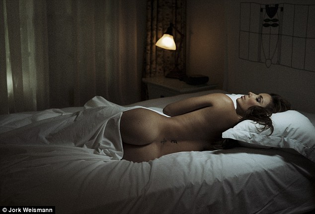 Peachy: Eva Longoria shows off her perfectly toned posterior in an arty photograph for the new book Asleep at the Chateau