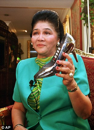 Shoe lover: Imelda Marcos' love of shoes extended to other objects as well, as this 1999 picture of her holding a shoe-shaped telephone shows