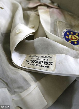 Wrecked: Hundreds of pieces of late strongman Ferdinand Marcos' clothing, including his formal native Barong shirts have also begun to gather mould and fray after being stored without protection at the presidential palace and Manila's National Museum