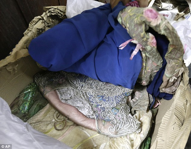 Lost relics: As well as shoes, long gowns, known as 'Terno', once worn by Imelda Marcos, are among the items to be damaged