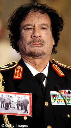 Brutal: Colonel Gaddafi beat and raped kidnapped schoolgirls he used as sex slaves in between checking his emails, according to a new book