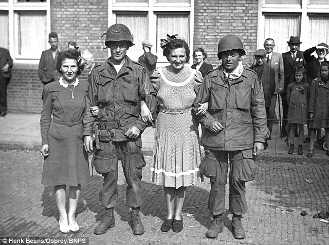 American soldiers of the 101st Airbourne Division celebrate with the local girls in Eindhoven