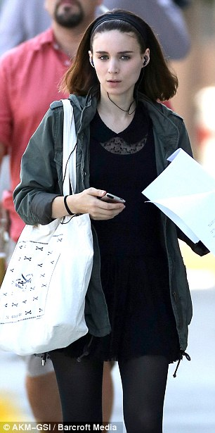 More script reading: Mara kept her locks down as she walked around and listened to music when they weren't filming