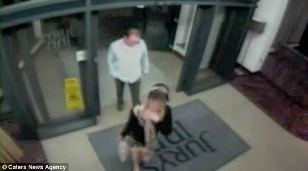 CCTV footage shows John Shaw checking into a hotel with a girl who is clutching a large teddy bear