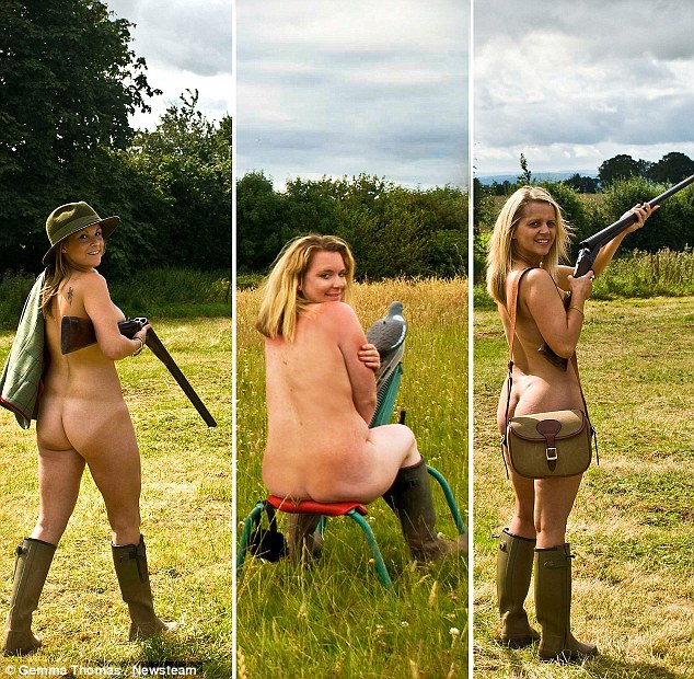 The girls used guns as props as they posed totally nude in a field