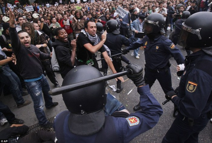 The demonstration in Athens came just 24 hours after similar clashes in Madrid (pictured) where protesters battled with Spanish police