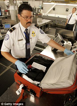 Tempting?: A TSA security officer goes through a passenger's bag suitcase (Stock image)
