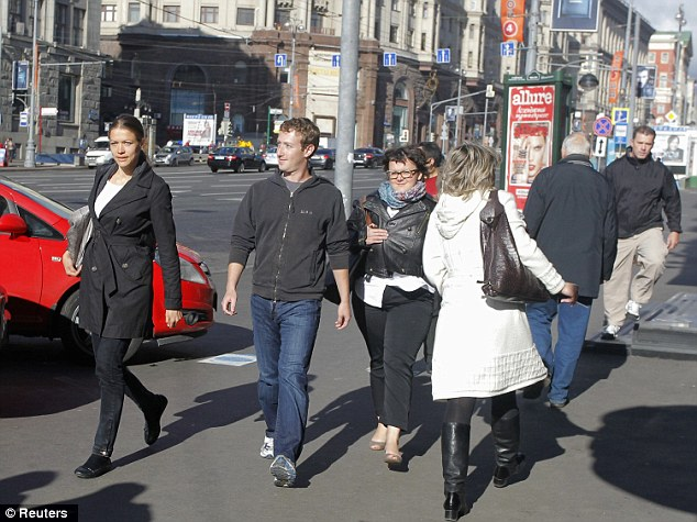 Anonymous: Facebook CEO and self-made millionaire Mark Zuckerberg goes unrecognised as he walks around the streets of Russia